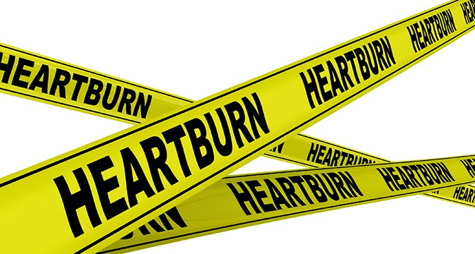 """Yellow warning tapes with inscription """"HEARTBURN"""". Isolated"""